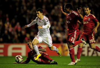 LIVERPOOL, ENGLAND - MARCH 18:  Eden Hazard of Lille breaks clear of the challenges of Daniel Agger and Glen Johnson (R) of Liverpool during the UEFA Europa League Round of 16, second leg match at Anfield on March 18, 2010 in Liverpool, England.  (Photo b