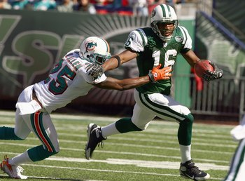 EAST RUTHERFORD, NJ - SEPTEMBER 23: Brad Smith #16 of the New York Jets runs with the ball against Will Allen #25 of the Miami Dolphins during their game on September 23, 2007 at Giants Stadium in East Rutherford, New Jersey. The Jets defeated the Dolphin