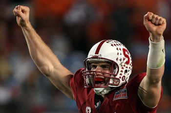 MIAMI, FL - JANUARY 03:  Andrew Luck #12 of the Stanford Cardinal celebrates after he threw a 38-yard touchdown pass in the fourth quarter against the Virginai Tech Hokies during the 2011 Discover Orange Bowl at Sun Life Stadium on January 3, 2011 in Miam