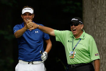 BETHESDA, MD - JUNE 14:  Jeff Overton celebrates a hole-in-one on the 13th hole with Butch Harmon during a practice round prior to the start of the 111th U.S. Open at Congressional Country Club on June 14, 2011 in Bethesda, Maryland.  (Photo by Rob Carr/G