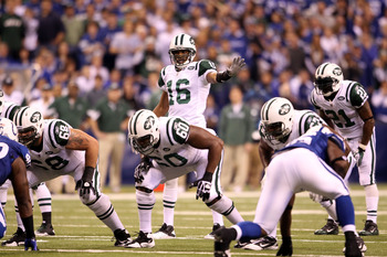 INDIANAPOLIS, IN - JANUARY 08:  Brad Smith #16 of the New York Jets gestures as he lines up in the wildcat formation at quarterback against the Indianapolis Colts during their 2011 AFC wild card playoff game at Lucas Oil Stadium on January 8, 2011 in Indi