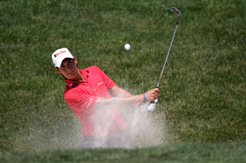 BETHESDA, MD - JUNE 15:  Matteo Manassero of Italy plays a bunker shot during a practice round prior to the start of the 111th U.S. Open at Congressional Country Club on June 15, 2011 in Bethesda, Maryland.  (Photo by Ross Kinnaird/Getty Images)
