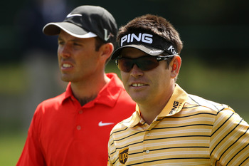 BETHESDA, MD - JUNE 14:  Charl Schwartzel (L) and Louis Oosthuizen of South Africa walk off a tee during a practice round prior to the start of the 111th U.S. Open at Congressional Country Club on June 14, 2011 in Bethesda, Maryland.  (Photo by Andrew Red