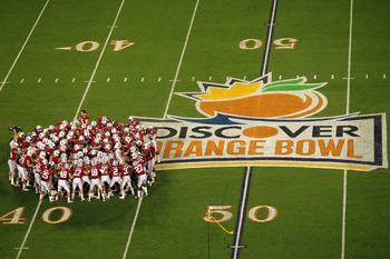 MIAMI, FL - JANUARY 03:  The Stanford Cardinal huddle on the field prior to playing against the Virginia Tech Hokies during the 2011 Discover Orange Bowl at Sun Life Stadium on January 3, 2011 in Miami, Florida. Stanford won 40-12.  (Photo by Mike Ehrmann