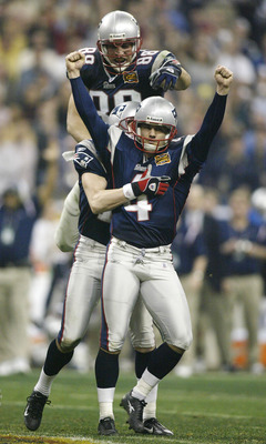 HOUSTON, TX - FEBRUARY 1:  Kicker Adam Vinatieri #4 of the New England Patriots celebrates with his teammates Christian Fauria #88 and Ken Walter #13 after kicking a 41-yard game-winning field goal in the forth quarter during Super Bowl XXXVIII against th