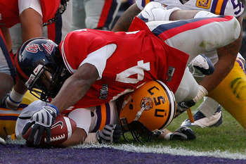 BATON ROUGE, LA - NOVEMBER 22:  Brandon Bolden #34 of the Ole Miss Rebels dives for a touchdown against  the Louisiana State University Tigers  on November 22, 2008 at Tiger Stadium in Baton Rouge, Louisiana.  (Photo by Chris Graythen/Getty Images)