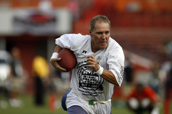 MIAMI, FL - JANUARY 26: Former Miami Dolphin Jim Kiick heads down field against the Miami Hurricanes at the Orange Bowl January 26, 2008 in Miami, Florida. This is the last game to be played in the Orange Bowl. (Photo by Eliot J. Schechter/Getty Images)