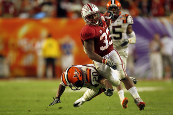 MIAMI, FL - JANUARY 03:  Stepfan Taylor #33 of the Stanford Cardinal runs the ball against the Virginai Tech Hokies during the 2011 Discover Orange Bowl at Sun Life Stadium on January 3, 2011 in Miami, Florida. Stanford won 40-12. (Photo by Mike Ehrmann/G