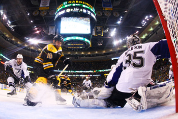 BOSTON, MA - MAY 27:  Nathan Horton #18 of the Boston Bruins shoots his game winning third period goal past Dwayne Roloson #35 of the Tampa Bay Lightning in Game Seven of the Eastern Conference Finals during the 2011 NHL Stanley Cup Playoffs at TD Garden