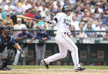 SEATTLE - JUNE 05:  Adam Kennedy #4 of the Seattle Mariners hits a game tying RBI single in the eighth against the Tampa Bay Rays at Safeco Field on June 5, 2011 in Seattle, Washington. (Photo by Otto Greule Jr/Getty Images)
