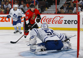 OTTAWA, ON - NOVEMBER 27:  Jesse Winchester #18 of the Ottawa Senators has his wrist shot stopped by a kick save by Jonas Gustavsson #50 of the Toronto Maple Leafs during a game at Scotiabank Place on November 27, 2010 in Ottawa, Ontario, Canada.  (Photo