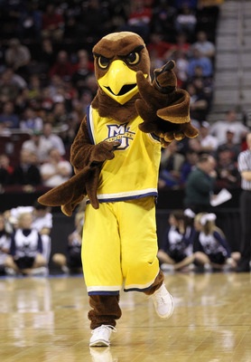 CLEVELAND, OH - MARCH 18: The Marquette Golden Eagles mascot walks on the court during the game against the Xavier Musketeers during the second round of the 2011 NCAA men's basketball tournament at Quicken Loans Arena on March 18, 2011 in Cleveland, Ohio.