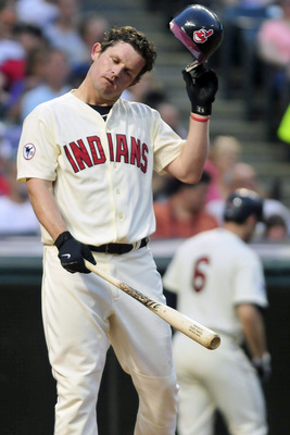 CLEVELAND, OH - JUNE 4: Austin Kearns #26 of the Cleveland Indians reacts after striking out to end the sixth inning against the Texas Rangers at Progressive Field on June 4, 2011 in Cleveland, Ohio. The Rangers defeated the Indians 4-0. (Photo by Jason M