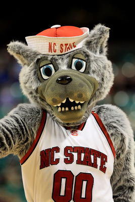 GREENSBORO, NC - MARCH 10:  Mr. Wuf, North Carolina State mascot, performs during the first half of the game against the Maryland Terrapins in the first round of the 2011 ACC men's basketball tournament at the Greensboro Coliseum on March 10, 2011 in Gree