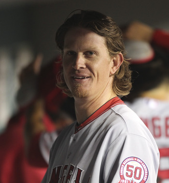 SEATTLE - JUNE 14:  Starting pitcher Jered Weaver #36 of the Los Angeles Angels of Anaheim smiles in the dugout at the end of the seventh inning against the Seattle Mariners at Safeco Field on June 14, 2011 in Seattle, Washington. Weaver threw a complete