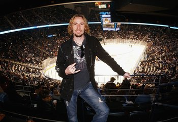 ATLANTA, GA - MARCH 16:  Chad Kroeger of the group Nickelback relaxes during the game between the Atlanta Thrashers and the New York Islanders at Philips Arena on March 16, 2006 in Atlanta, Georgia. The Thrashers defeated the Islanders 4-2.  (Photo by Sco
