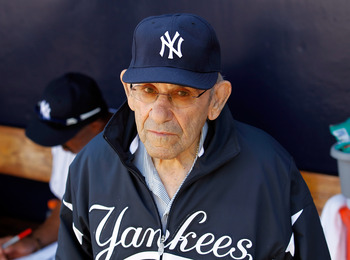 TAMPA, FL - FEBRUARY 26:  Hall of Famer Yogi Berra of the New York Yankees stands in the dugout just prior to the start of the Grapefruit League Spring Training Game against the Philadelphia Phillies at George M. Steinbrenner Field on February 26, 2011 in