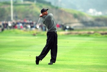 17 Jun 2000:  Tiger Woods follows his swing during the 100th US Open at the Pebble Beach Golf Links in Pebble Beach, California.Mandatory Credit: Jamie Squire  /Allsport