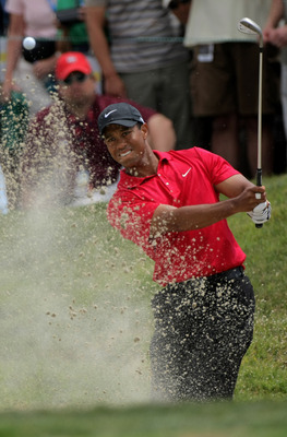 SAN DIEGO - JUNE 16:  Tiger Woods pitches out of a sandtrap as he takes his third shot on the ninth hole during the playoff round of the 108th U.S. Open at the Torrey Pines Golf Course (South Course) on June 16, 2008 in San Diego, California.  (Photo by D