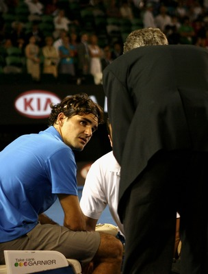 MELBOURNE, AUSTRALIA - JANUARY 19:  Roger Federer of Switzerland receives medical treatment on his foot during his third round match against Janko Tipsarevic of Serbia on day six of the Australian Open 2008 at Melbourne Park on January 19, 2008 in Melbour