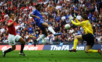 LONDON - MAY 19:  Didier Drogba of Chelsea beats Edwin Van der Sar of Manchester United to score their first goal during the FA Cup Final match sponsored by E.ON between Manchester United and Chelsea at Wembley Stadium on May 19, 2007 in London, England.