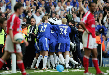 LONDON - MAY 7:  Team mates swamp Claude Makelele of Chelsea after he scores the winning goal in the final seconds during the Barclays Premiership match between Chelsea and Charlton at Stamford Bridge on May 7, 2005 in London, England.  (Photo by Mike Hew