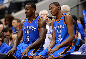DALLAS, TX - MAY 19:  Kendrick Perkins #5 and Kevin Durant #35 of the Oklahoma City Thunder wait to enter the game in the third quarter while taking on the Dallas Mavericks in Game Two of the Western Conference Finals during the 2011 NBA Playoffs at Ameri