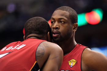 DALLAS, TX - JUNE 07:  Dwyane Wade #3 and Chris Bosh #1 of the Miami Heat talk on court against the Dallas Mavericks in Game Four of the 2011 NBA Finals at American Airlines Center on June 7, 2011 in Dallas, Texas. NOTE TO USER: User expressly acknowledge