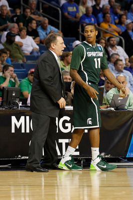 TAMPA, FL - MARCH 17:  Head coach Tom Izzo of the Michigan State Spartans talks with Keith Appling #11 against the UCLA Bruins during the second round of the 2011 NCAA men's basketball tournament at St. Pete Times Forum on March 17, 2011 in Tampa, Florida