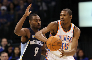 OKLAHOMA CITY, OK - MAY 15:  Forward Kevin Durant #35 of the Oklahoma City Thunder dribbles the ball against Tony Allen #9 of the Memphis Grizzlies in Game Seven of the Western Conference Semifinals in the 2011 NBA Playoffs on May 15, 2011 at Oklahoma Cit