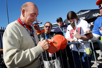 FORT WORTH, TX - NOVEMBER 07:  Sportscaster Dick Vitale (L) signs fans memorabilia prior to the start of the NASCAR Sprint Cup Series AAA Texas 500 at Texas Motor Speedway on November 7, 2010 in Fort Worth, Texas.  (Photo by Todd Warshaw/Getty Images)