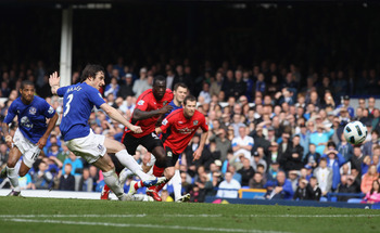 LIVERPOOL, ENGLAND - APRIL 16: Leighton Baines  of Everton scores the second goal from the penalty spot during the Barclays Premier League match between Everton and Blackburn Rovers at  Goodison Park on April 16, 2011 in Liverpool, England.  (Photo by Cli