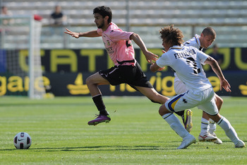 PARMA, ITALY - MAY 01:  Javier Matias Pastore of US Citta di Palermo turns Rolf Gunther Feltscher Martinez of Parma FC during the Serie A match between Parma FC and US Citta di Palermo at Stadio Ennio Tardini on May 1, 2011 in Parma, Italy.  (Photo by Val