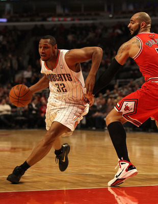 CHICAGO, IL - FEBRUARY 15: Boris Diaw #32 of the Charlotte Bobcats moves around Carlos Boozer #5 of the Chicago Bulls at the United Center on February 15, 2011 in Chicago, Illinois. The Bulls defeated the Bobcats 106-94. NOTE TO USER: User expressly ackno
