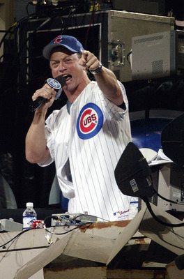 CHICAGO - OCTOBER 8:  Actor Gary Sinise sings 'Take Me Out To The Ballgame' during the seventh inning stretch of game two of the National League Championship Series between the Florida Marlins and the Chicago Cubs on October 8, 2003 at Wrigley Field in Ch