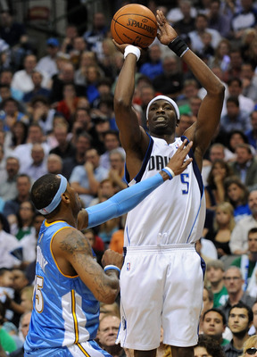 DALLAS - MAY 11:  Forward Josh Howard #5 of the Dallas Mavericks takes a shot against Carmelo Anthony #15 of the Denver Nuggets in Game Four of the Western Conference Semifinals during the 2009 NBA Playoffs at American Airlines Center on May 11, 2009 in D