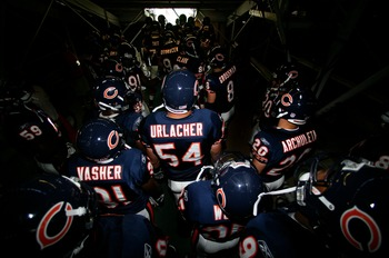 SAN DIEGO - SEPTEMBER 9:   Linebacker Brian Urlacher #54 of the Chicago Bears and his teammates prepare to enter the game against San Diego Chargers at Qualcomm Stadium September 9, 2007 in San Diego, California.  (Photo by Donald Miralle/Getty Images)