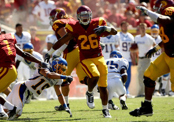 LOS ANGELES - SEPTEMBER 5:  Running back Marc Tyler #26 of the USC Trojans carries for 64 yards against the San Jose State Spartans on September 5, 2009 at the Los Angeles Coliseum in Los Angeles, California.   (Photo by Stephen Dunn/Getty Images)