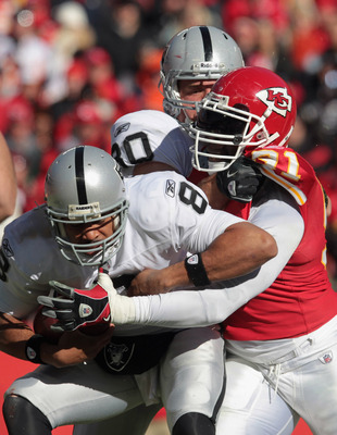 KANSAS CITY, MO - JANUARY 02:  Quarterback Jason Campbell #8 of the Oakland Raiders is sacked by Tamba Hali #91 of the Kansas City Chiefs during the game on January 2, 2011 at Arrowhead Stadium in Kansas City, Missouri.  (Photo by Jamie Squire/Getty Image