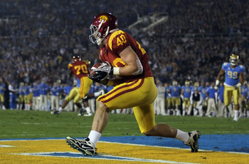 PASADENA, CA - DECEMBER 04:  Tight end Rhett Ellison #30 of the USC Trojans catches a pass for touchdown in the first quarter against the UCLA Bruins at the Rose Bowl on December 4, 2010 in Pasadena, California.  (Photo by Jeff Gross/Getty Images)
