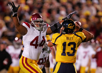 BERKELEY, CA - OCTOBER 03:  Kevin Riley #13 of the California Golden Bears is pressured by Christian Tupou #44 of the USC Trojans at California Memorial Stadium on October 3, 2009 in Berkeley, California.  (Photo by Ezra Shaw/Getty Images)