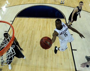 HOUSTON, TX - APRIL 04:  Kemba Walker #15 of the Connecticut Huskies goes to the basket against the Butler Bulldogs during the National Championship Game of the 2011 NCAA Division I Men's Basketball Tournament at Reliant Stadium on April 4, 2011 in Housto