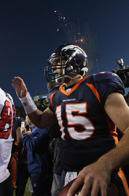 DENVER - DECEMBER 26:  Quarterback Tim Tebow #15 of the Denver Broncos greets members of the Houston Texas at midfield after the game at INVESCO Field at Mile High on December 26, 2010 in Denver, Colorado. The Broncos defeated the Texans 24-23.  (Photo by