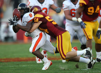 LOS ANGELES - OCTOBER 24: Wide receiver James Rodgers #8 of the Oregon State Beavers hangs on to a pass for a reception against linebacker Chris Galippo #54 of the USC Trojans on October 24, 2009 at the Los Angeles Coliseum in Los Angeles, California.   (