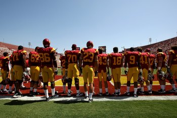 LOS ANGELES - SEPTEMBER 5:  The USC Trojans stand in a tribute to team friend and fan Ryan Davidson, who passed away earlier this year at the age of 16, during pregame ceremonies befoe playing the San Jose State Spartans on September 5, 2009 at the Los An