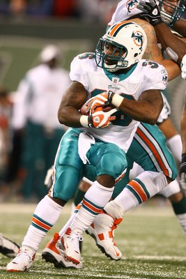 EAST RUTHERFORD, NJ - DECEMBER 28:  Lousaka Polite #36  of The Miami Dolphins runs the ball against The New York Jets during their game on December 28, 2008 at Giants Stadium in East Rutherford, New Jersey.  (Photo by Al Bello/Getty Images)