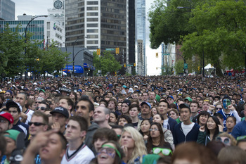 VANCOUVER, CANADA - JUNE 13: Fans gather on the streets of downtown Vancouver to watch Game Six of the 2011 NHL Stanley Cup Playoffs on June 13, 2011 in Vancouver, British Columbia, Canada.  (Photo by Rich Lam/Getty Images)