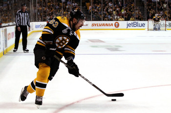 BOSTON, MA - JUNE 13:  Brad Marchand #63 of the Boston Bruins skates with the puck during Game Six of the 2011 NHL Stanley Cup Final at TD Garden on June 13, 2011 in Boston, Massachusetts.  (Photo by Elsa/Getty Images)