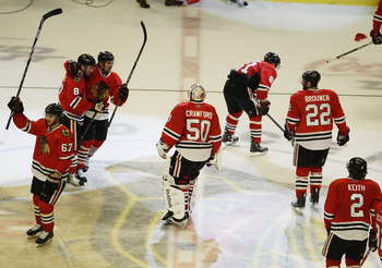 CHICAGO, IL - APRIL 24: Members of the Chicago Blackhawks including Corey Crawford #50 salute the crowd and celebrate a win over the Vancouver Canucks in Game Six of the Western Conference Quarterfinals during the 2011 NHL Stanley Cup Playoffs at the Unit