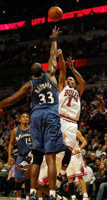 CHICAGO - JANUARY 15: Derrick Rose #1 of the Chicago Bulls puts up a shot on his way to a game and career high 37 points against Brendan Haywood #33 of the Washington Wizards at the United Center on January 15, 2010 in Chicago, Illinois. The Bulls defeate
